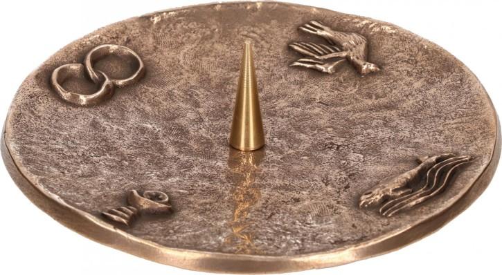Symbolleuchter aus Bronze
